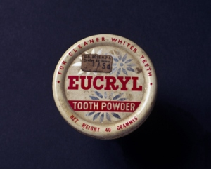 Made by Eucryl Limited, Southampton. The inscription on the lid reads 'Eucryl Toothpowder/For Cleaner Whiter Teeth. Net Weight 40 Grammes'. Toothpowders and toothpastes are thought to have been used as long ago as 500 BC in China. They did not appear in Britain until the late 18th century, and were applied using brushes by the rich, while the poor used their fingers. Many of the early powders probably caused more harm than good, as they contained abrasive substances such as china, brick dust and cuttlefish.